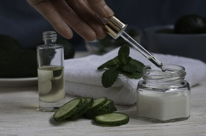 Natural ingredients for homemade cucumber face mask on white wooden background